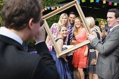 Wedding guests at drinks reception with antique picture frame, Photography by one thousand words wedding photographers www.onethousandwords.co.uk