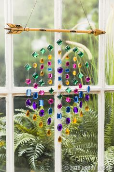 For boho, eye-catching charm, we tied the string first, and then glued on the jewels (one on both sides of the string).