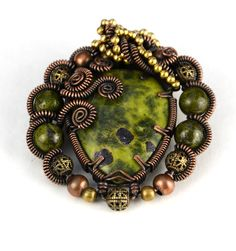 Lonely Soldier Designs  Wire wrap pendant.   Copper wire wrapped Serpentine centre and beads with copper and brass beads.