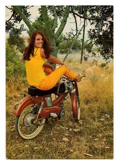 70s. girl sitting on her moped.