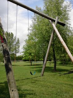 coolest swing set ever!! Made out of telephone poles! :]