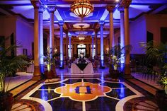 A look at the blue uplighting on columns we will do and also a picture of the Driskill potted palms that we could accent the room with. Possibly two potted Driskill palms to flank the entrance to the ballroom where the ceremony will take place.