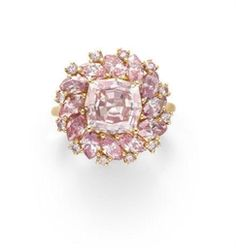 A COLORED DIAMOND RING Set with a modified octagonal-cut fancy pink diamond, weighing approximately 3.03 carats, within a marquise and circular-cut pink diamond concentric surround, mounted in 18k rose gold.