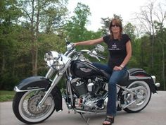 Me and my Deluxe, love her! This is my 2005 Softtail Deluxe!  She is a gem! Every inch of her is chromed out. People stop and stare. Literally! Every thing has been upgraded with