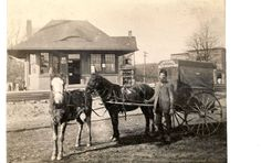 Feb. 13, 1911 in front of the railroad depot.  This was Loveland RFD #4 mail wagon and mailman. - Loveland