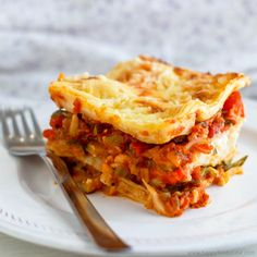 Hearty Vegetable Lasagne.  Lasagne is a very popular Italian dish that is creamy and rich and so is its vegetarian version. Layers of pasta sheets, vegetables and white sauce topped with cheese make definitely a mouth-watering comfort dish that is hard to say no to! http://www.happyfoodstube.com/hearty-vegetable-lasagne/ #lasagne #lasagna #vegetarian
