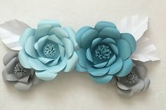 como fazer flores de papel passo a passo.