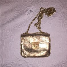 "FLASH SALETalbots gold leather micro/crossbody bag Super cute tiny crossbody for when you only need a few essentials. Definitely a tiny bag! Measures 5.5"" across 4.5"" high and 1.25"" wide. Has two interior compartments and a turn lock closure. There is a scratch on the right top corner shown in the last picture. No trades! Open to offers but please no low balling! Talbots Bags Crossbody Bags"