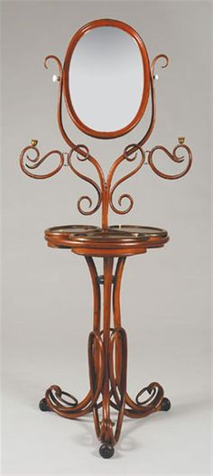Austrian Bentwood Adjustable Dressing Table Thonet Having an oval swivel mirror flanked by scrolling supports on an adjustable circular standard flanked by scrolling branches ending in candle holders, above three storage compartments with swivel tops contained within a ring frame, raised on a tripartite base with scrolling legs ending in ring devices.