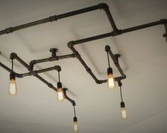 Items similar to Industrial Steampunk Black Pipe Chandelier on Etsy - Kronleuchter Industrial Light Fixtures, Light, Light Fixtures, Diy Light Fixtures, Ceiling Lights Diy, Diy Industrial Lighting, Industrial Lamp, Black Light Fixture, Industrial Lighting