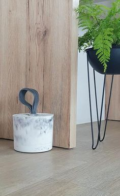 A hand made, stylish and functional addition to your entry way featuring a marble effect concrete and grey nylon handle. We hand produce these doorstops in our White Concrete, Chalk Design, Concrete, Door Stop, Sanding, Modern, Homeware, Marble Effect, Entryway
