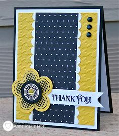 beautiful card with lovely balanced design... on my computer it looks to be navy + yellow with accents of white..all very striking, but, it is black with the other colors, still a great color combo...
