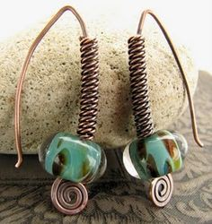 Love the wirewrapping and love the beads are gorgeous