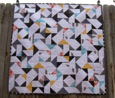 Happy Quilting: MQG Riley Blake winner 3.  I really like the use of greys and black in this one to tone down the color.  Would love to make this pattern