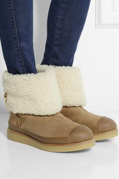 Tory Burch | Margaret leather-trimmed shearling boots | NET-A-PORTER.COM