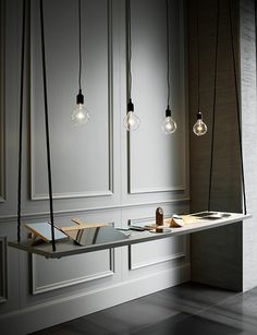 Studiopepe created this refined hanging shelf for a Spotti showroom exhibit.