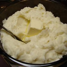 Make-Ahead Mashed Potatoes Allrecipes.com  Review:  Cooked the potatoes in chicken broth. When I was mashing them I added about 5 ozs cream cheese, 8 oz sour cream, 1/2 cup heavy cream (b/c I wanted to use it up), and garlic powder, salt and pepper. Put them in the crock pot w/ a few pats of butter, and popped in the fridge overnight. Christmas morning I took them out and let them thaw a bit on the counter, then cooked on the low setting of the crock pot for about 4 hrs.