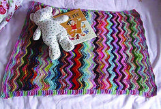 A really sweet pram blanket which is a great way to use up scraps of variegated or solid yarns.