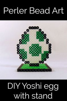 Easy to follow instructions on how to make a stand for your Perler Bead creations. This one happens to be a Yoshi egg from Mario, but the directions can be adapted to any Perler Bead sprite. #crafts #craftsforkids #perlerbeads #mario
