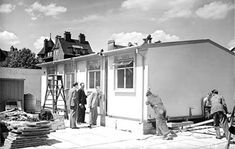 Pushing a 'Pre fab' into place late Pre fabricated, temporary housing was extremely important in post Britain. East End London, Old London, Prefab Houses, Temporary Housing, History Online, Barnet, History Photos, British History, 1960s