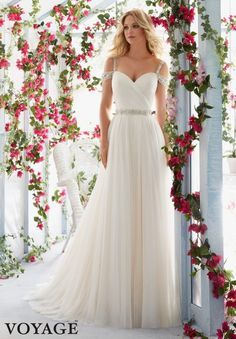 CRYSTAL BEADED EMBROIDERED STRAPS ON COLD SHOULDER, ASYMMETRICALLY DRAPED BODICE WITH SOFT TULLE SKIRT AND BEADED WAISTBANDColors available: White, Ivory, Light Gold.