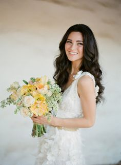 This effortless wedding hairstyle for long hair is perfect for no-fuss brides who still want to look glamorous. Loose curls make a stylish statement for wedding hair and give you a natural wedding hair look – we love this glowing bride's curls from @Style Me Pretty
