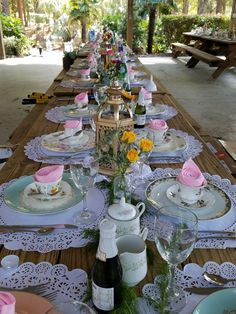 Beautiful table styling for tea with doilies, greenery and vintage china and blush, mint, and gold color palette. Available to replicate and rent as needed for up to 150 guests