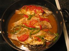 Jamaican Steamed Fish Recipe Main Dishes with snappers, black pepper, fish, butter, red bell pepper, sliced, green bell pepper, slice, onions, tomatoes, salt, black pepper, hot pepper sauce, thyme, tomato ketchup, lime, hot water