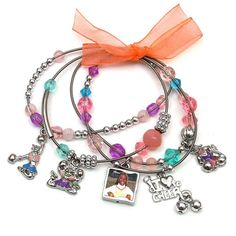 """A Charmed Life - Cheer Crazy  Show your spirit! Four strand stretch bracelet has reversible photo charm. One size, medium.  Upload and shrink photos online. Print at home for free! Holds photo size: 0.52"""" x 0.52"""". Frame size: SQ"""