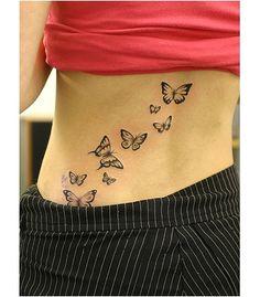 Rug tattoo: een zwerm vlinders. Deze afbeelding behoort niet tot seiza.ro. Alle tattoo voorbeelden uit deze categorie zijn bedoeld alleen om vrij te bekijken en ideeen op te doen. Onze collectie van originele tattoo voorbeelden, vindt u in de categorie 'Tattoo Ontwerpen'