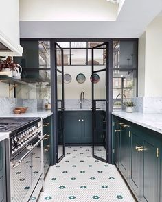 """Farrow & Ball on Instagram: """"Swooning over this contemporary kitchen! Our tip? Coordinate the colour of cabinetry (painted here in #StudioGreen) with floor tiling for a…"""""""