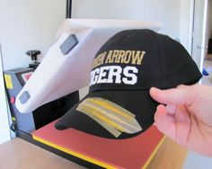 Big things are happening around here today - I have a tutorial for you on how to add heat transfer vinyl to hats and caps (without any special heat press attachments) and we have a very special