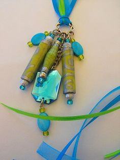 PAPER PEARLS JEWELRY - NEW PRODUCTS..$11.00 Handpainted paper beaded pendant.  Wear with ribbon as shown or slip your favorite chain through.  Add some bling to your purse or key chain.  Makes a great one of a kind gift.