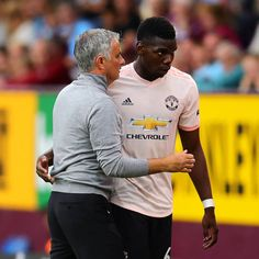 Manchester United manager Jose Mourinho embraces Paul Pogba as he leaves the field after being substituted during the Premier League match between Burnley FC and Manchester United at Turf Moor on. Paul Pogba, Manchester United, José Mourinho, Burnley Fc, Premier League Matches, Evolution, Survival, Management, Leaves