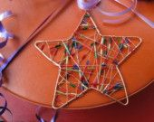 Copper wire dog with bone ornament. $6.50, via Etsy.