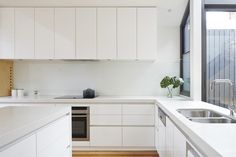 kitchen cabinets stop inline with end cabinets before window, hob extractor included in run