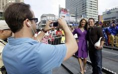 Drew Lachey poses with ABC Good Morning America's Ginger Zee on Fountain Square Monday morning as ABC News Producer David Meyers takes a photo with Zee's iPhone. The live segments highlighted the 2012 World Choir Games.