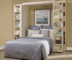 Murphy Beds.  If I had one of these in my guest room, I could make my guest room my craft room, too.  Hmmm...