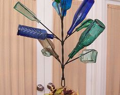 Awesome Blossom southern garden yard 49 Bottle Tree - Wine, beer, and art glass Bottletree stake folk art Pebble Painting, Pebble Art, Stone Painting, Bottle Torch, Beer Bottle Crafts, Wine Bottle Trees, Painting Templates, Rainbow Loom Bracelets, Bottle Wall