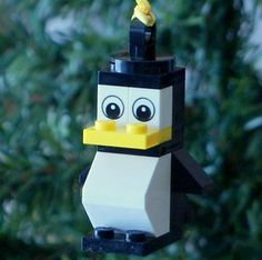Need to get one of these! My love of penguins and lego combined :D LEGO Little Penguin Christmas Ornament by ornaments4charity