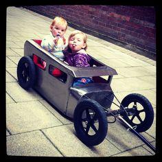 Mini Thelma & Louise showing attitude in their Tot-Rod.