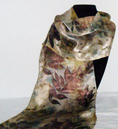 Natural dyes on silk.  Sumac leaves and hibiscus blossoms steamed on satin silk charmeuse.