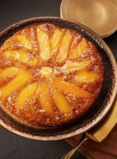 A caramelized mango topping highlights the sweet flavor of traditional upside-down cake.
