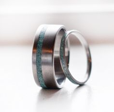 Wedding ring idea! Not sure how I feel about a full turquoise band for smaller ring, but love this