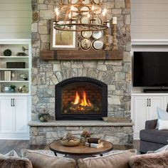 With a graceful arch, the Cerona gas fireplace adds style and warmth, with seamless, cantilevered corners and textured detail. Corner Gas Fireplace, Natural Gas Fireplace, Country Fireplace, Cottage Fireplace, Farmhouse Fireplace, Stove Fireplace, Fireplace Remodel, Fireplace Mantle, Fireplace Design