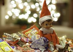 Elf helps himself to leftover Halloween candy