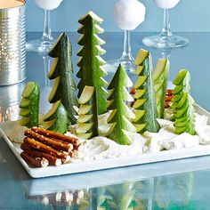 Liven up your veggie tray this holiday season with this adorable snowy scene, made with cucumbers, zucchinis and everyone's favorite dip—Ranch! Christmas Party Food, Christmas Appetizers, Noel Christmas, Christmas Goodies, Appetizers For Party, Christmas Treats, Xmas, Christmas Veggie Tray, Best Party Food