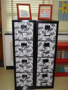 These were regular yucky gray file cabinets that the teacher covered in something . . . love it!