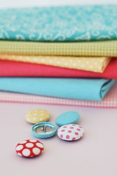 Fabric Covered Buttons Tutorial. Great tutorial - definitely better than the instructions that came with my button making kit!
