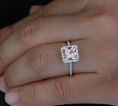 14k White Gold 7mm Morganite Princess Cut and Diamonds Single Emerald Cut Halo Ring (Choose color and size options at checkout)  I absolutely love this ring and I'm not a huge fan of princess cut normally, but this is gorgeous!!! I wouldn't say no to this one.